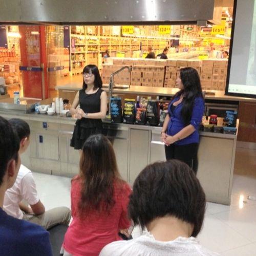 Presenting-coffee-Burdet-to-staff